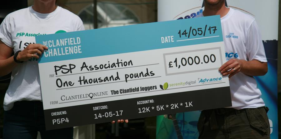 Image-of-one-thousand-pound-cheque-being-presented-to-PSPA
